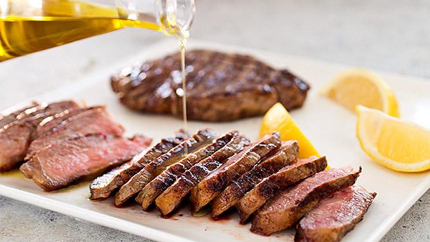 You should put olive oil on steak before grilling