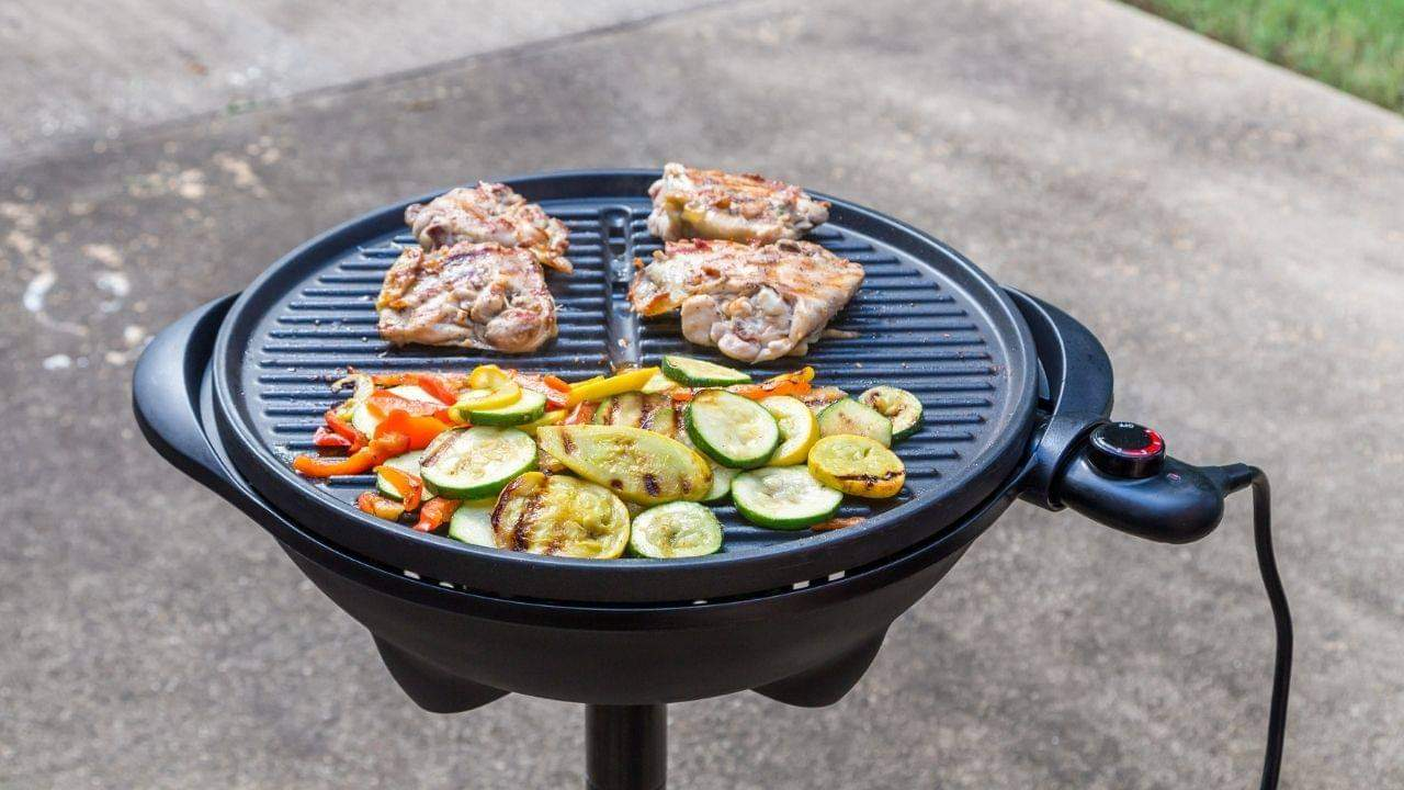 Using charcoal or wood chips is the best way to get a charcoal flavor on an electric grill