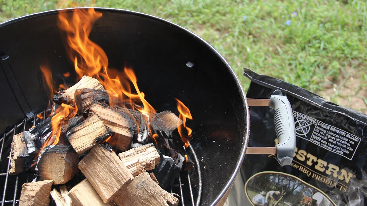 Burning woods in a charcoal BBQ